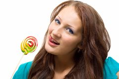 Lovely young woman with lolipop Royalty Free Stock Image