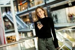 Free Lovely Young Woman Looking On Mobile Phone In Shopping Center Royalty Free Stock Images - 103942319