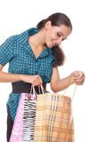Lovely young woman looks in the bag for shopping Royalty Free Stock Photography
