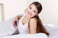 Lovely young woman lying in bed Stock Image