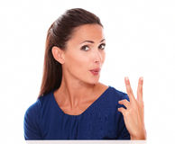 Lovely young woman making a victory sign Stock Images