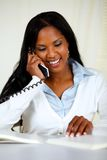 Lovely young woman on phone Stock Photography