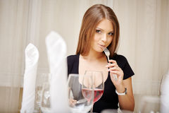 Lovely young woman posing during lunch Royalty Free Stock Images