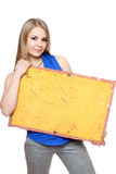 Lovely young woman posing with yellow board Royalty Free Stock Photography