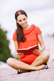 Lovely young woman reads book Royalty Free Stock Images