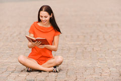 Lovely young woman reads book Stock Photo