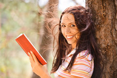 Lovely young woman reads book Stock Photos