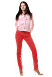 Lovely young woman in red jeans Royalty Free Stock Photography