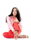 Lovely young woman in red jeans. Isolated Royalty Free Stock Photography