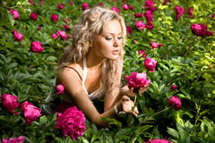 Lovely young woman relaxing on a garden Stock Photo