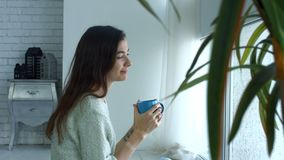 Lovely young woman relaxing in the morning at home stock video footage