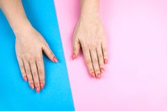 Lovely young woman`s hands on colored background. royalty free stock image