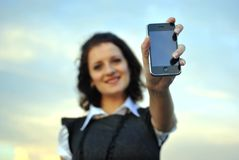 Lovely young woman showing mobile phone Royalty Free Stock Photo