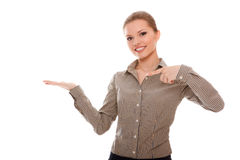 Lovely young woman showing something on his palm Royalty Free Stock Photo