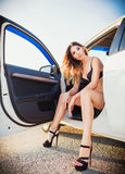 Lovely young woman sitting in car Stock Photography