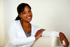 Lovely young woman smiling and looking at you Royalty Free Stock Photo