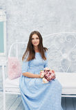 Lovely young woman in the spring dress with flowers Royalty Free Stock Photos