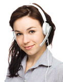 Lovely young woman is talking to customers Royalty Free Stock Photography