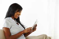 Lovely young woman using a tablet PC Royalty Free Stock Images