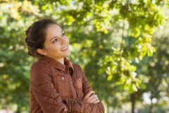 Lovely young woman wearing a brown coat posing Stock Images