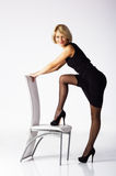 Lovely young woman wth chair Stock Image