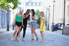 Girls are back in town. Lovely young women having fun in the city streets Royalty Free Stock Photography