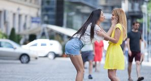 Girls are back in town. Lovely young women having fun in the city streets Royalty Free Stock Photos