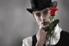 Lover. Portrait of a young gentlemen wearing dinner jacket and black top hat. Shot in a studio Stock Photos