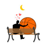 Lover Basketball. Guy and ball sitting on bench. Romantic date. Royalty Free Stock Photography
