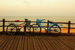 Lover and bicycle. In a seashore, pair of young people were in love, left behind 2 bicycles Royalty Free Stock Image