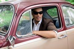 Lover-boy in a car Stock Photos