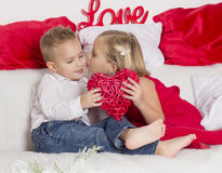 Lover boy gives girl heart Royalty Free Stock Photography