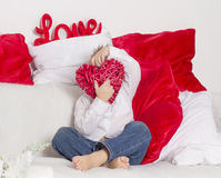 Lover boy hides his face behind heart Stock Image