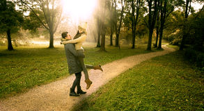 Lover boy lifts the girl  Stock Image