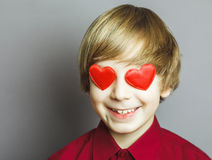 Lover boy. Portrait of a boy with hearts on face Stock Photo