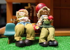 Lover. Couple couples sat sit bench leaned against each other eat apples love hat hats toy Royalty Free Stock Photos
