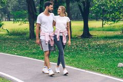 Lover Couple Holding Together And Walking In The Park Stock Photography