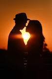 Lover couple in sunset Royalty Free Stock Photo