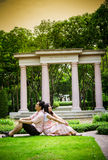 Lover couples sit in the garden2 Stock Images