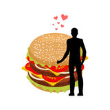 Lover fast food. Man and hamburger embrace. Guy and Burger. Love. Rs Romantic date fastfood. Glutton Lifestyle Stock Photos