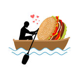 Lover fast food. Man and hamburger ride in boat. Guy and Burger. Lovers of sailing. Romantic date fastfood. Glutton Lifestyle Stock Photos