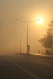Lover in foggy street. Lover walk on foggy street under morning sun Royalty Free Stock Photo