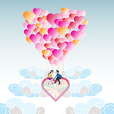 Lover on heart balloon flying among the cloud with blue sky Royalty Free Stock Photos
