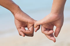 Lover holding finger. Walking on the beach Royalty Free Stock Images