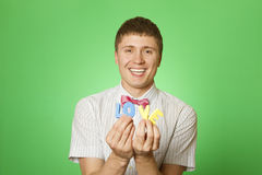 Lover man holding the letter love Stock Photography