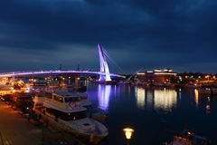Lover`s Bridge at Fisherman`s Wharf lights up the mouth of the Tamsui River at night. New Taipei City, Taiwan - August 3, 2017 - Lover`s Bridge, popular with Royalty Free Stock Images