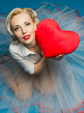 Lover's day. Woman holding a big heart on Valentine's Day Stock Photo