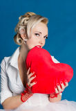 Lover's day. Woman holding a big heart on Valentine's Day Stock Images