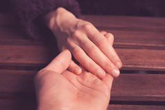 Lover's holding hands royalty free stock photo