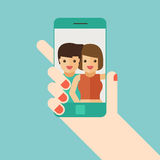 Lover selfie with smartphone on blue background Royalty Free Stock Images